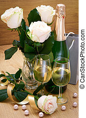 Glasses with champagne and white roses