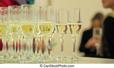 Glasses with champagne drink on festive table. People spending time on party. Luxury wealth prosperity lunch party, celebration catering elements. High quality 4k footage