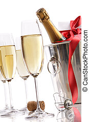 Glasses with Champagne in ice bucket and gift