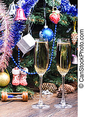 Glasses with champagne on the background of a decorated Christmas tree