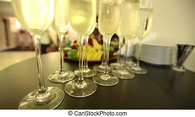 Glasses with champagne on the festive New Year's table