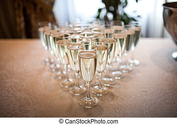 Glasses with champagne on the table