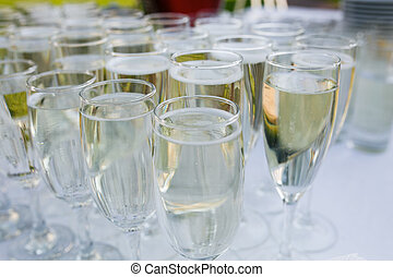 Glasses with champagne on the table on wedding