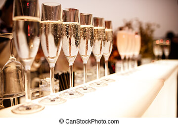 Glasses with champagne - Row of glasses with champagne on...