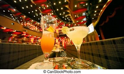 glasses with cocktails on table in concert hall