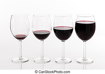 Glasses with different quantities of red wine - Four glasses...