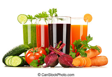 Glasses with fresh vegetable juices isolated on white