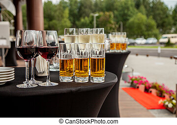 Glasses with juice, glasses with red wine on a buffet table
