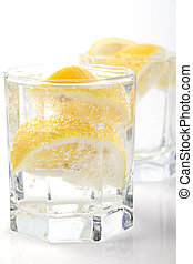 glasses with soda water and lemon - two glasses with soda...