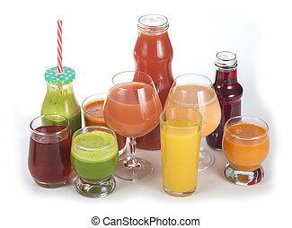 Glasses with various fresh vegetable juices on white