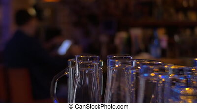 Glassware and man with pad in cafe - Close-up shot of clean...