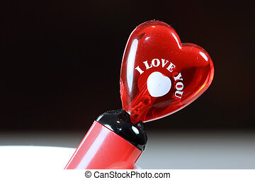 Glassy heart with I Love You note - Red pen with heart...