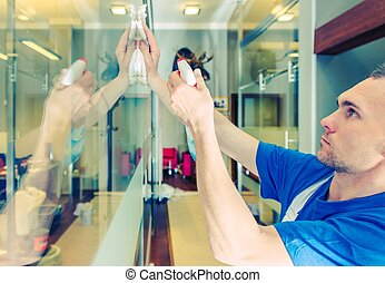Glassy Office Interior Cleaning. Caucasian Men Cleaning...