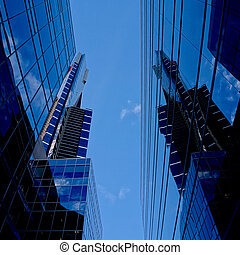 Clouds reflected in the windows of a modern building in Melbourne