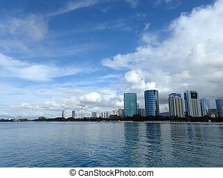 Glassy water of Ala Moana Beach with Condo buildings and...