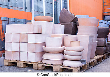 Glazed and unglazed ceramic flower pots in a variety of...