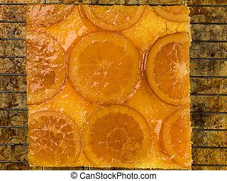 Glazed Candied Orange Sponge Cake on an Oven Cooling rack
