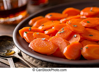 Glazed Carrots - A plate of delicious maple glazed carrots ...