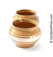 Glazed ceramic pot for cooking on a white background with clipping path
