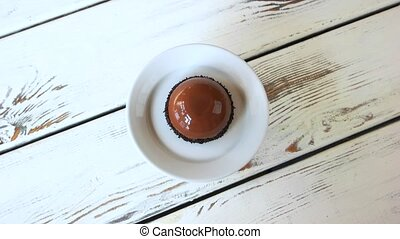 Glazed french mousse with cocoa flavor. French pastry with...