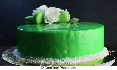 glazed green decorated cake moves around - glazed green...
