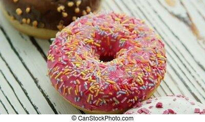 Glazed sweet doughnuts in closeup - Closeup shot from above...
