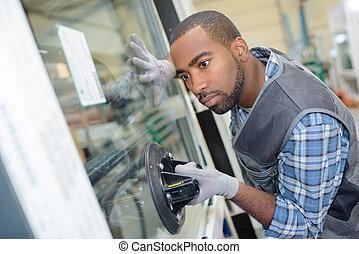 glazier fixing a glass window