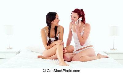 Gleeful attractive woman phoning