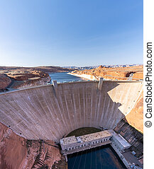 Glen Canyon Dam with Lake Powell in the Desert rural area of Page city Arizona, United States. USA Landmark environmental water resources reservoir and electricity concept.