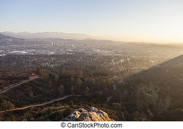 View of Glendale, California in misty morning light from Bee Rock in Los Angeles's Griffith Park.