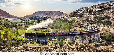 glenfinnan, estrada ferro, viaduct, em, escócia, com, a, jacobite, trem vapor, contra, pôr do sol, sobre, lago