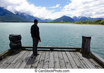 Glenorchy New Zealand NZ NZL - Man looks at dramatic...
