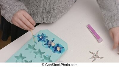 Glicerine soap DIY - Preschool child making glicerine soap...