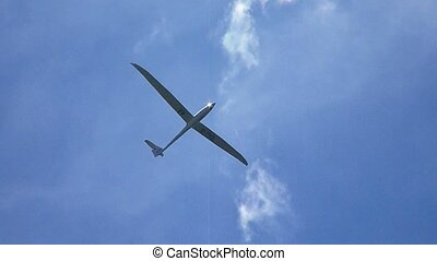 Glider against blue sky