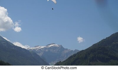 Glider in mountains. Alpine peaks landskape background....
