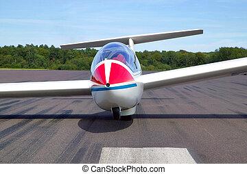 Glider on a runway