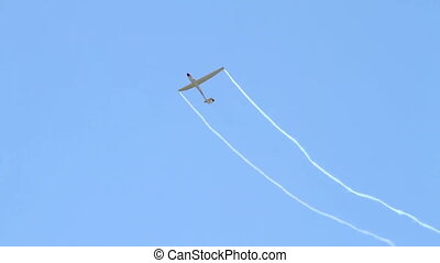 Glider performing aerobatics - Sailplane performing...
