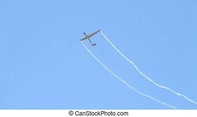 Glider performing aerobatics - Sailplane performing...