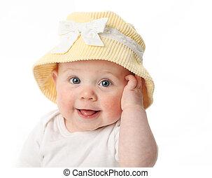 glimlachende baby, het dragen van een hoed