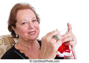 glimlachende vrouw, breiwerk, bejaarden, haar
