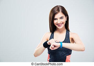 glimlachende vrouw, gebruik, activiteit, tracker
