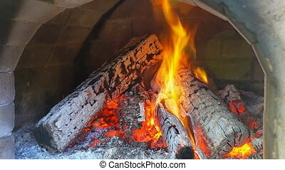 Glimpse into a wood fire oven before the pizza comes Slow...