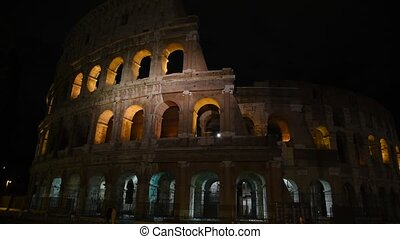 Glimpse of the Colosseum at night, in Rome.