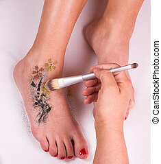Glitter tattoo on a caucasian woman's leg.