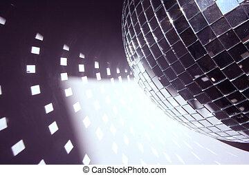 glitterball and light shapes - a glitterball reflecting...