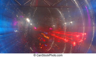 glitterball spinning with patterns of light filmed in club