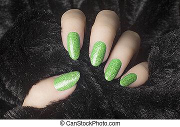 glittered green nails manicure