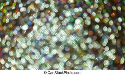 Glittering brilliance in blur - Flickering of colored...