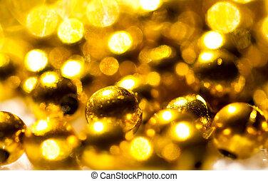 Glittering golden beads background