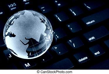 Global Computing - Glass Globe on a Keyboard